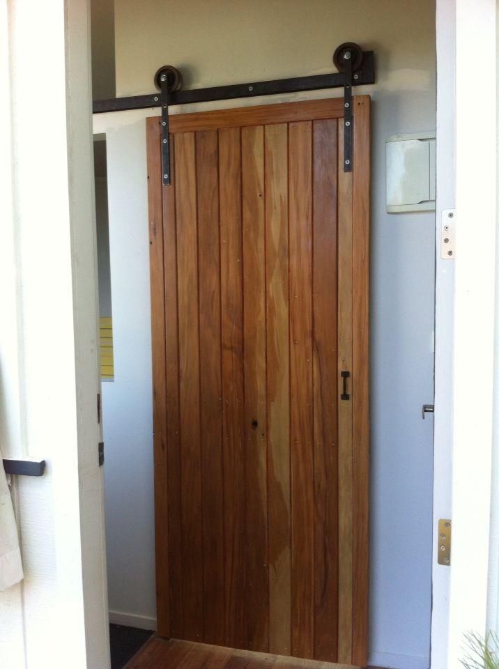 Recycled Rimu door with home made steel door track.