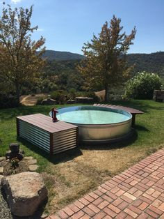 stock tank pool with curved bench for dipping' feet