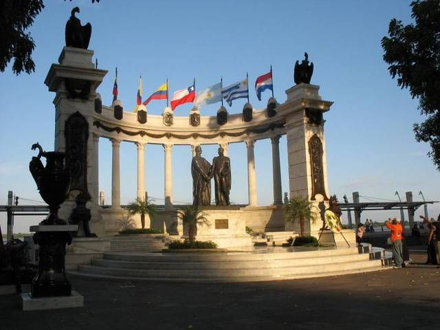 La Rotonda, Guayaquil is an inspiring monument especially at night when lighted. It depicts the meeting between Bolivar and San Martin from 1822. The wall behind the statue is an acoustic reflector capable of picking up tiny sounds.