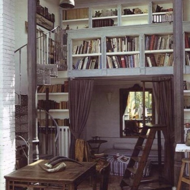 The Mezzanine/loft Library With Reading Nook Below.