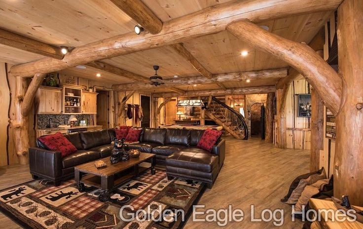 Beautiful log beams and wood flooring in the finished for Log cabin with basement