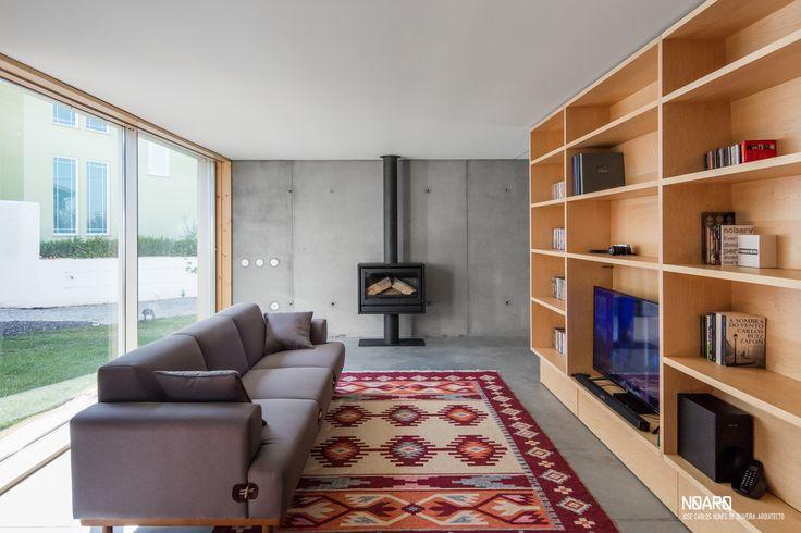 MAMI HOUSE – Living room view - #noarq #house #interior #living #window #wooodshelves #concretewalls #concretefloor by José Carlos Nunes de Oliveira - © NOARQ - Photography by João Morgado