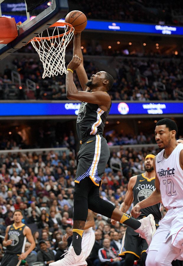 bd27a4f5afe Golden State Warriors forward Kevin Durant (35) goes to the basket against  Washington Wizards