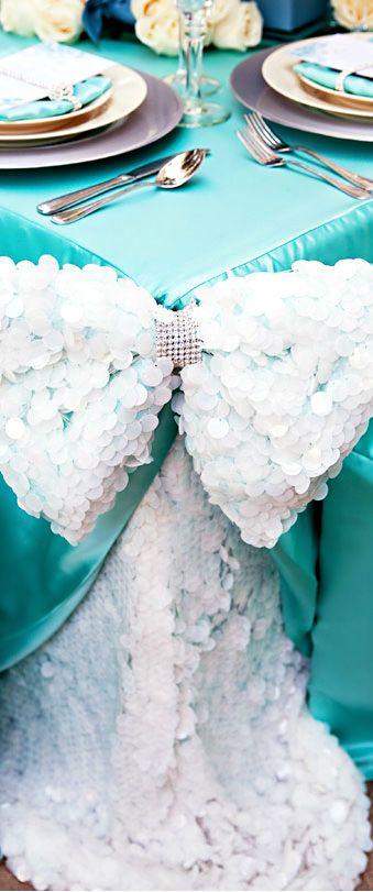 Huge Sequin Bow and Aqua Tablecloth.