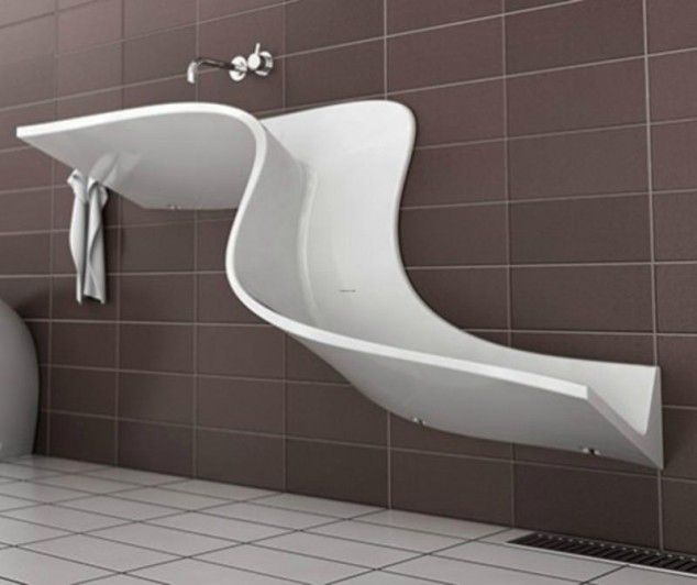 the abisko washbasin from eumar isnt even a basin its a freaking waterslide a waterslide sink that drains onto the floor how hilarious would it be if