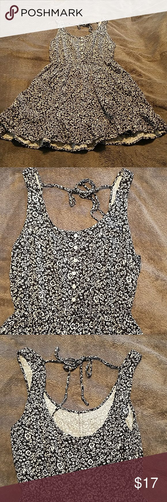 Black and white floral pattern festival dress Adorable summer dress! Scoop back with a tie at the top. Size xs. Very comfortable and light. Perfect for summer and festival season ! Brand is Lorimer NYC. Fp listed for exposure. Free People Dresses Mini
