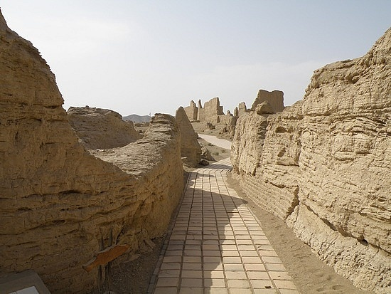 Ancient City of Jiaohe, Jiaohe Ruins. Located 10 kilometers west of Turpan in China's Xinjiang Province, the Jiaohe Ruins is the largest, oldest, and best preserved earthen city on earth. The city of Jiaohe was the capital of the Jushi Kingdom from 108-450BC.