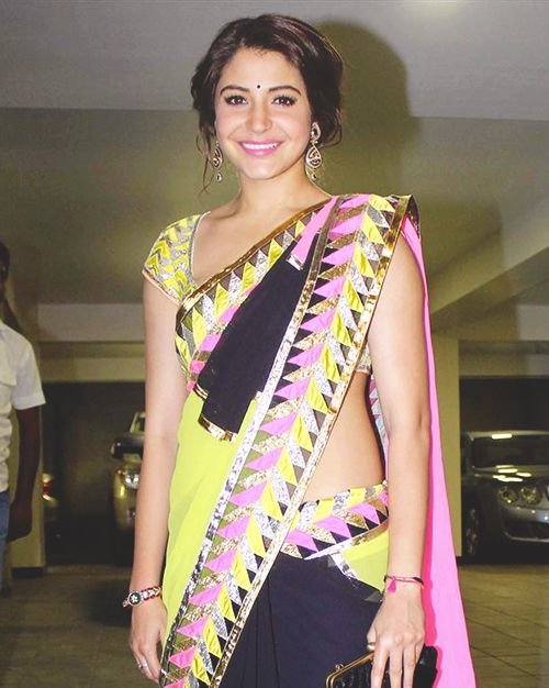 Don't really like her sari, but love her hair and makeup.