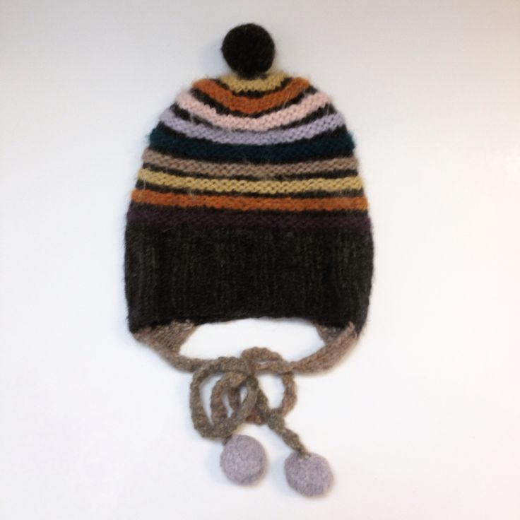 Knitted hat from leftover yarn makes for an unusual color combination for me.