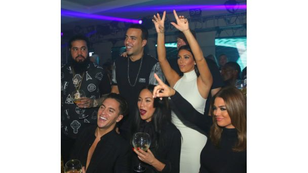 Out and About: Celebrate! Kim Kardashian parties inside VIP room nightclub in Abu Dhabi with French Montana and some guests after the F1 race championship, where Lewis Hamilton took home the title once again.