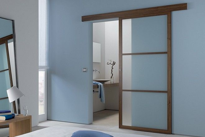 Wood-line timber sliding doors in walnut and clear glass