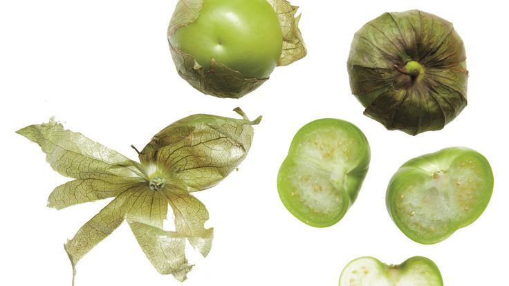 Tomatillos look like small green tomatoes but are actually related to the Cape gooseberry. Their papery husks should be removed before eating. You may know these tart, refreshing fruits, a staple in Latin cuisine, from their starring role as the main ingredient in salsa verde.