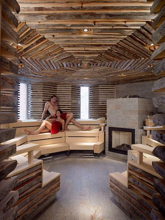 OH WHAT A SAUNA...are those the rocks for steam on top of the fireplace???  Not any traditional Finnish Sauna!!