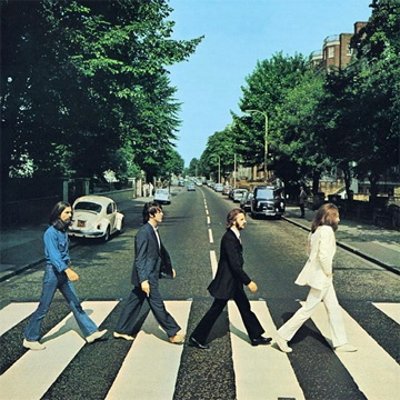 Abbey  road  Famous title of a 1969 album by The Beatles. Album cover shows the Beatles crossing Abbey Road in central London, England.