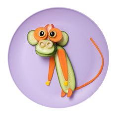 Photo: Funny monkey made of cucumber and carrot on plate