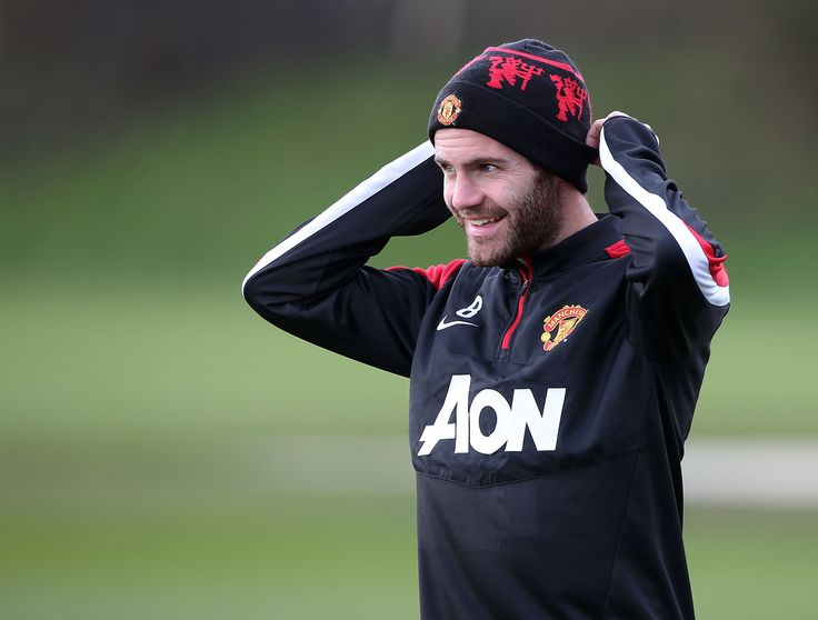 Juan Mata takes to the field ahead of a training session at @manutd's Aon Training Complex.