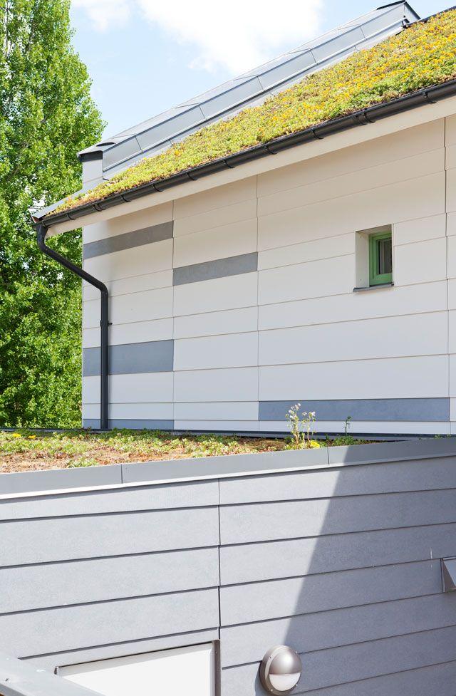 Passivhusets tak dekorerat med gräs.