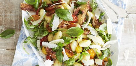 Take a look at this recipe (Gnocchi with Arugula, Tomatoes, and Bacon)