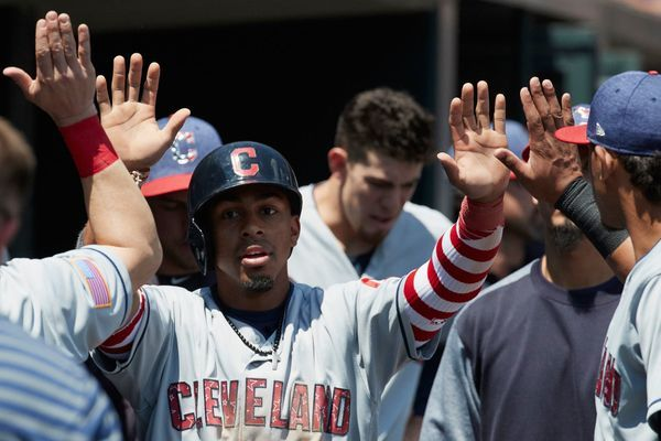 Cleveland Indians' Francisco Lindor, is congratulated by teammates after scoring against the Detroit Tigers in the fourth inning Bradley Zimmer behind. in Detroit, Sunday, July 2, 2017. (AP Photo/Rick Osentoski) Indians won 11-8