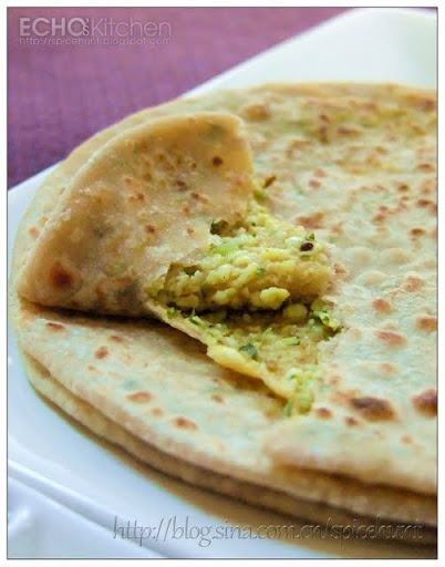 Paneer Paratha (Stuffed Cottage Cheese Flat bread)=So yummy!  I substituted a white Mexican cheese for the paneer and it was so good.  This was a fairly easy lunch for us.