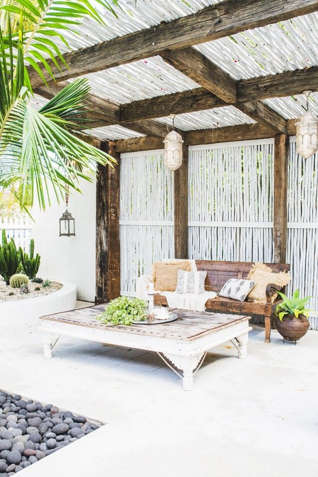 global style outdoor oasis with mudcloth pillows