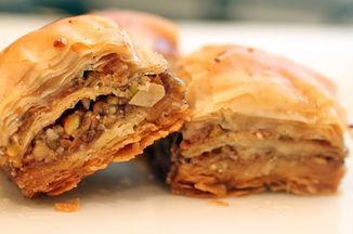 I love a rich and fulfilling cooking process and usually don't mind taking my time. But, authentic baklava is one of the most labor-intensive desserts as proven during my trip to Turkey.  I got a hands-on cooking lesson in homemade baklava, and it's an insanely beautiful and lengthy process. Yufka dough, similar to the store-bought phyllo we get here, comprises the layers, and each baklava has 100 of them.  Yes, 100 sheets are rolled out to create this delicious dessert. Typically, baklava…