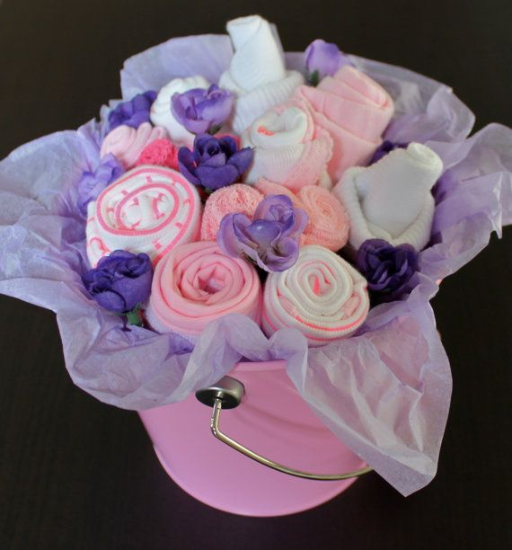 This baby clothes bouquet is the ideal gift for a baby shower or simply a welcome home present for an expecting mother of an adorable baby girl.on Etsy, $40.00