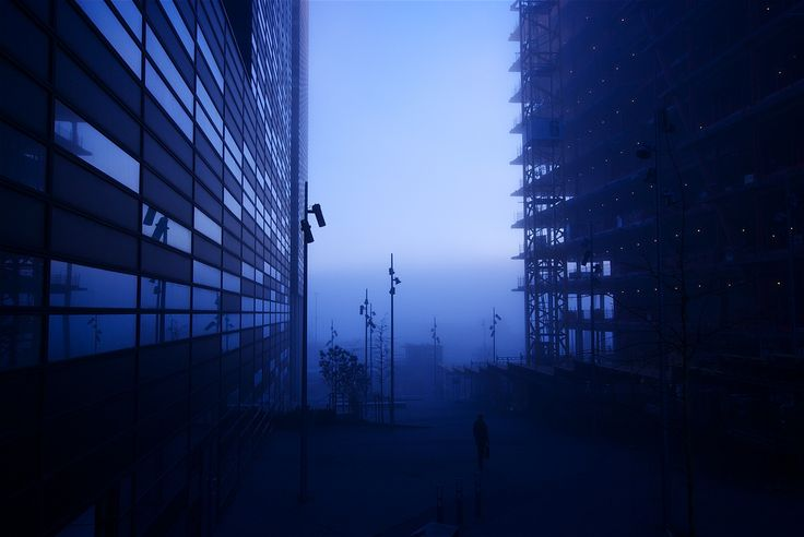 Bluecode by geir tønnessen - I think this shot show a lot what Oslo is all about in the winter, its dark, mysterious, cold and very often foggy. The man in this shot also came out perfect. He is a picture of how people often l...