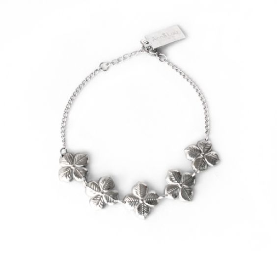#annalouoflondon A grown up version of those daisy chain bracelets you used to make as a child, these beautifully delicate gold, rose gold and silver plated stainless steel hyacinth bracelets are the easy way to bring Spring florals into your wardrobe and immediately have you dreaming of Summer walks in the park. Charm length 8cm.