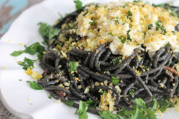 squid ink pasta with buttered crab
