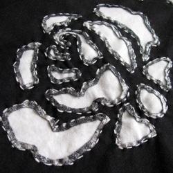 Close up of a reverse applique rose on an Alabama Stitch skirt.