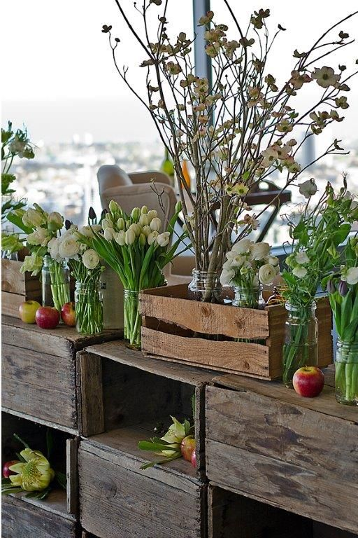 original apple crates with preserving jars for vases