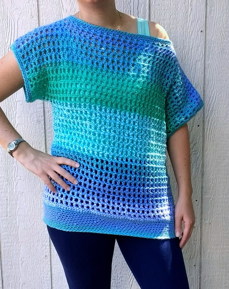 Crochet this super easy and breezy crochet top. The pattern features a wide and generous head opening for an off-the-shoulder look.