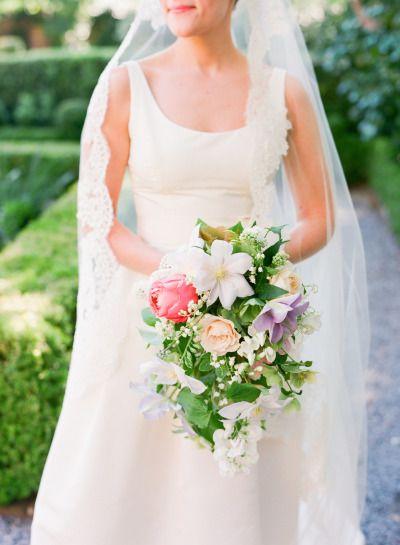 Elegant cascading bouquet: http://www.stylemepretty.com/2015/03/13/elegant-charleston-spring-wedding-at-hibernian-hall/ | Photography: Corbin Gurkin - http://corbingurkin.com/