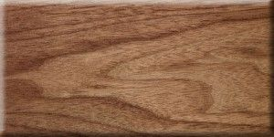 Walnut veneer with clear lacquer finish.