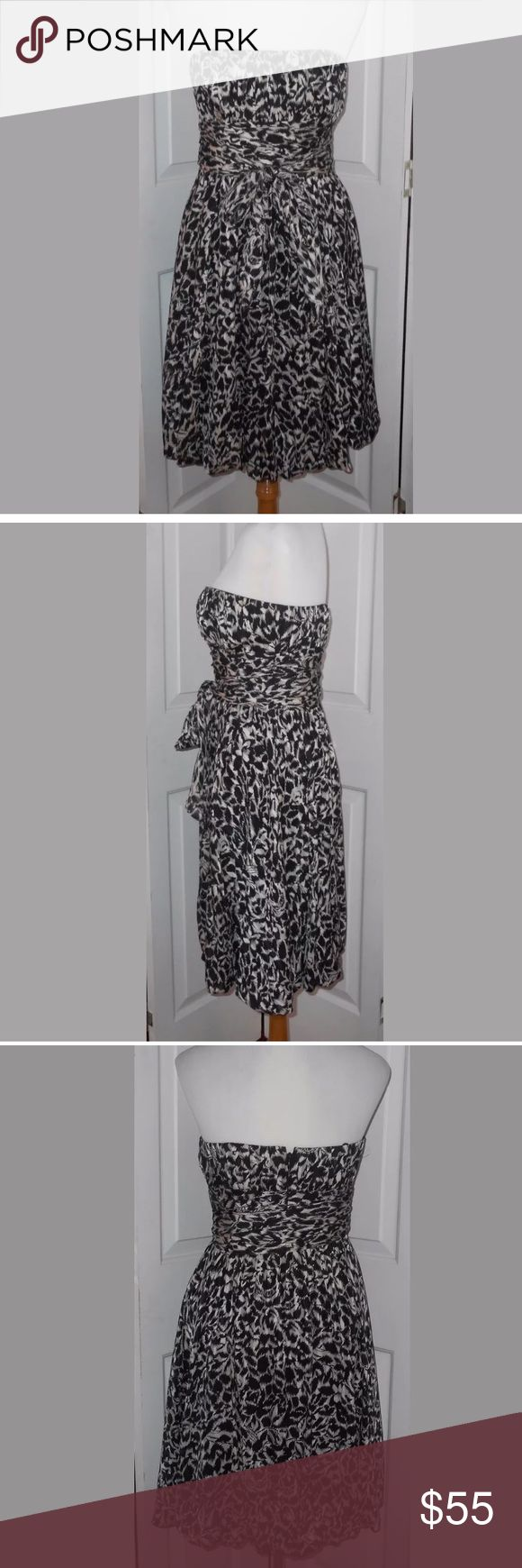 """BCBG MaxAzria Black Floral Print Silk Dress size 4 Gorgeous BCBG MaxAzria Black and Gray Floral Print 100% Silk Dress. Women's size 4. 100% Silk, Lining: 100% Polyester. It has boning up top, a back zipper, and a bubble hem for fullness. Measures approx: 16 1/2"""" pit to pit and 29"""" in length. BCBGMaxAzria Dresses"""