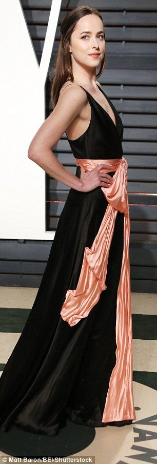 Stunning: She wore a black slinky number which had spaghetti straps and a low-cut neckline...