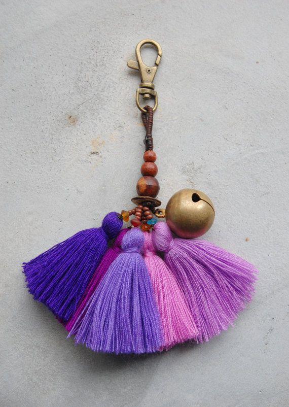 Accesorio del bolso púrpura borla bohemio