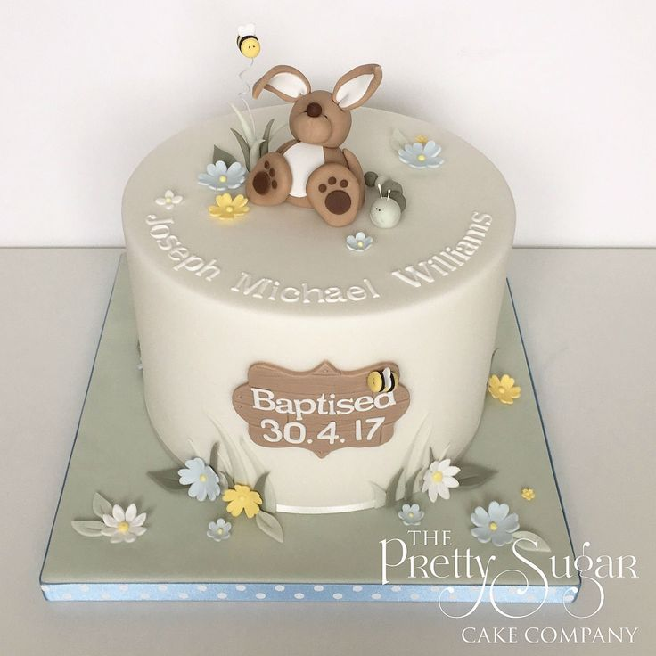 Christening cake with cute bunny, bees and caterpillar topper