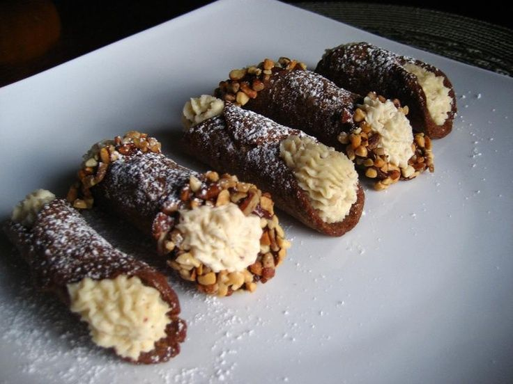 Lift a cannoli tube with a wire skimmer or large slotted spoon, out of the oil…