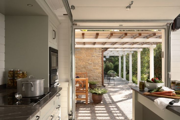 modern summer kitchen near the patio with black counter top, black and white color palette of Welcoming Summer with Cooking Al Fresco