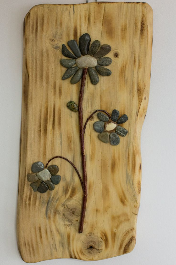 Three Flowers - Arrangement realized by gluing on a plank fir (finished rustic) of twigs and natural stone river carefully chosen.  These flowers do not need water or sun, they just need a place on your wall.