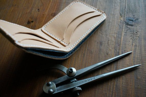The Chambray-Lined Natural Leather Bifold is the ultimate wallet that weve ever offered. It blends the best of everything we source for materials in our products:  -Lightweight Kurabo Mills Chambray cloth (imported from the most respected textile mill in Japan) -3 ounce Hermann Oak Natural Vegetable Tanned leather (considered the most respected leather tannery in the United States) -Ritza Tiger .8mm Waxed Polyester Thread  This bifold is made for the style conscious dude who still wants a…