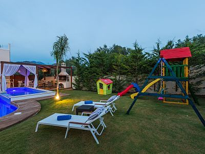 Rethymno villa rental - Lay by the pool and relax while your children are at the playground!