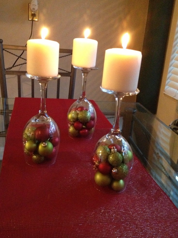 A different use for wine glasses....Christmas table decoration