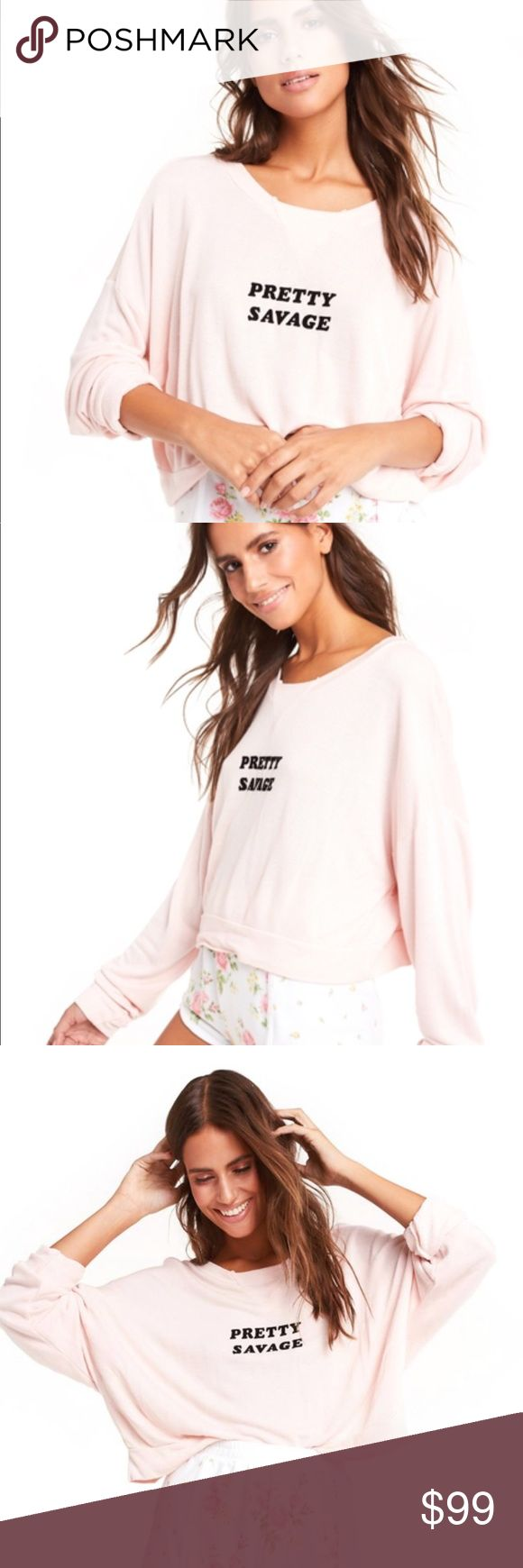 Wildfox Pretty Savage Pullover NWT. So soft and super cute. Color is a little pinker than the model photos. For more info please google style name ✌🏼 Note the Sweater is brand new and purchased it with the two very small ink marks wear the writing is. You can barely see it but have to mention every detail on here 🙄😁 Wildfox Sweaters