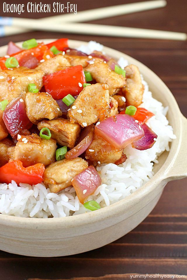 The most incredible Orange Chicken Stir Fry with pan seared chicken, red bell peppers, onion and a delicious sweet and savory sauce served over rice. So easy and so flavorful!
