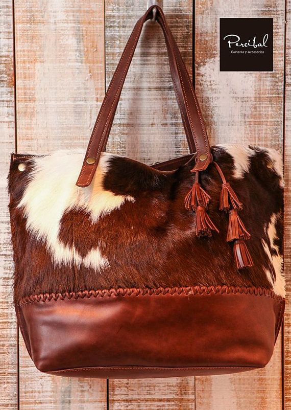 This cowhide and leather bag is perfect as your everyday bag, which can fit for…