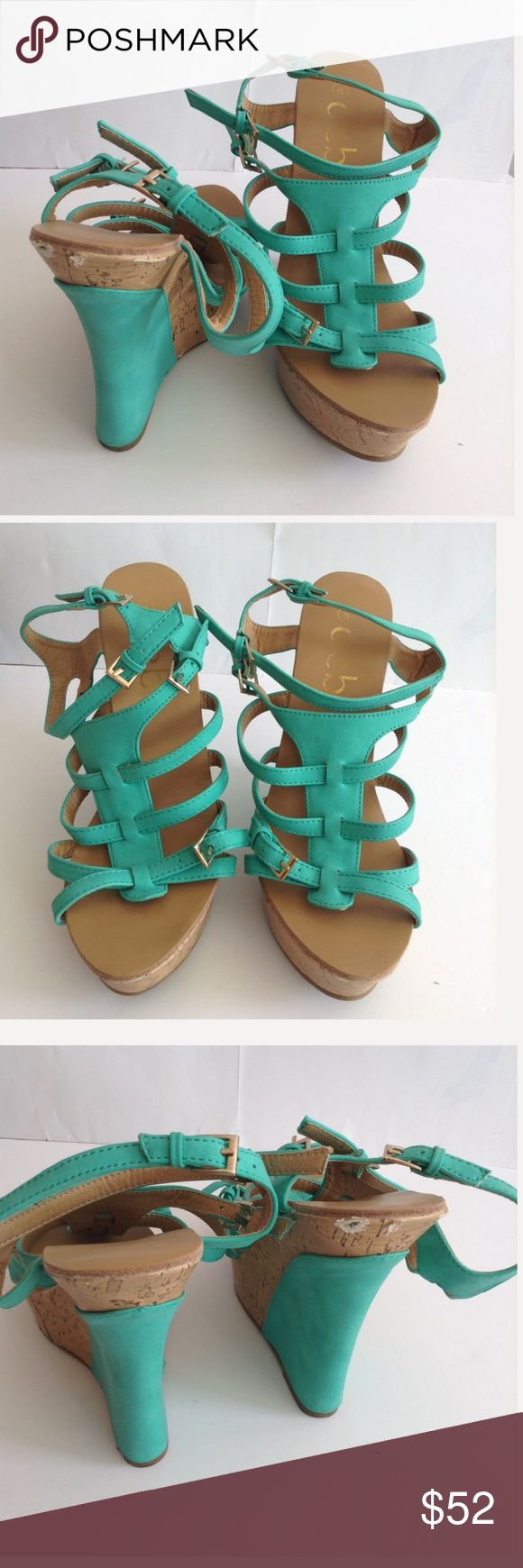Summer Statement Turquoise Teal Sandal Wedges These wedges are your must have summer statement. They are 5inch Teal Wedges. I Love these heels!!  Minor defects are not too noticeable when wearing them. Tall dark turquois wedge heel shoes. Minor defects can be viewed in the pictures. Deb Shoes Wedges