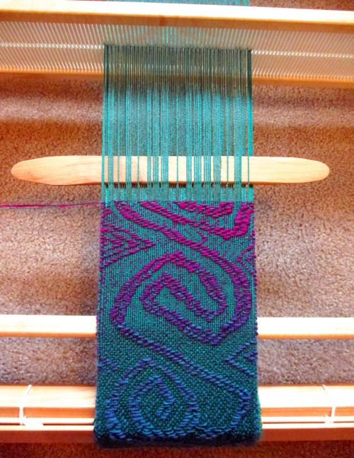 "lisa-rayner: I've had questions on exactly how I am making my freeform overshot mermaid scarf from people who belong to the Facebook Rigid Heddle Weaving group such as, ""do you use your pickup stick (in the Netherlands we call it pattern stick) in front of the heddle of at the back of it? And do you use the stick in a closed shed?""How I am weaving freeform overshot on my Flip rigid heddle loom:With the heddle in the neutral (closed shed) position, use the pick up stick (also called a…"